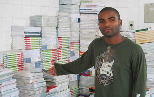Arthur Cesar, 18, with the unused books.
