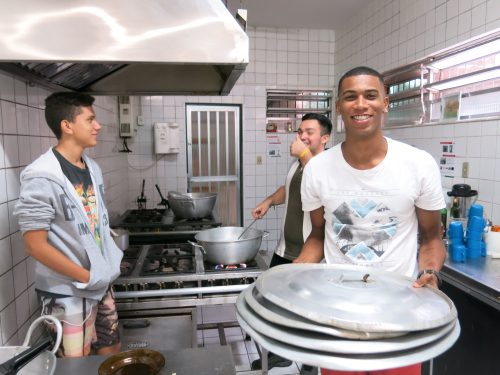 Pupils cook for each other in the empty canteen at Gomes Freire.